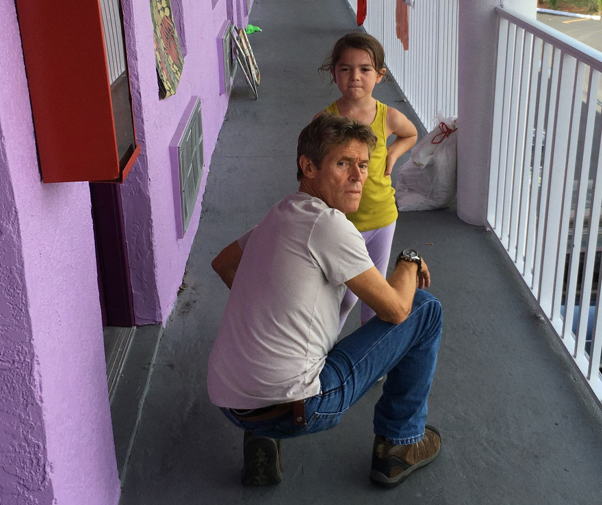 A man and child meet outside a room of a roadside motel in Florida.
