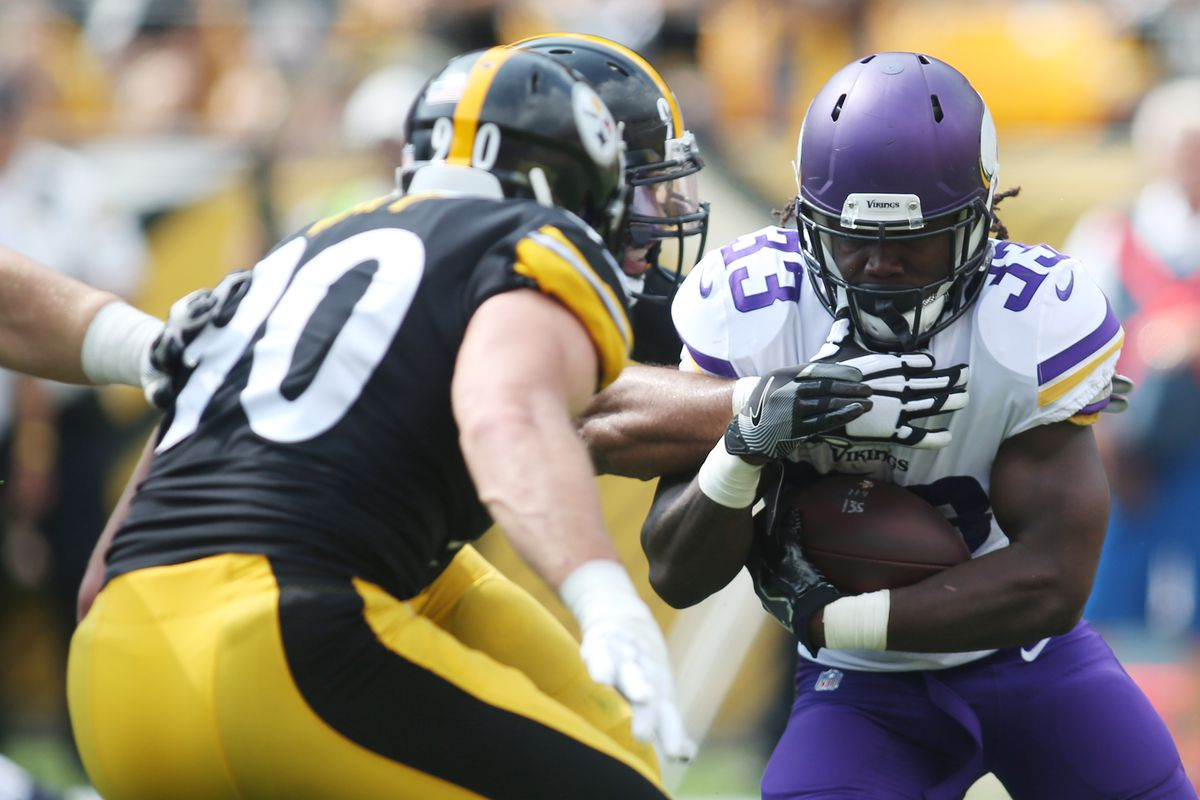 Minnesota Vikings running back Dalvin Cook carries the ball as Pittsburgh Steelers defensive end Cameron Heyward and outside linebacker T.J. Watt defend during the first quarter at Heinz Field.
