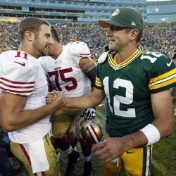 San Francisco 49ers' Alex Smith (11) shakes hands with Green Bay Packers' Aaron Rodgers (12) after an NFL football game Sunday, Sept. 9, 2012, in Green Bay, Wis. The 49ers won 30-22.