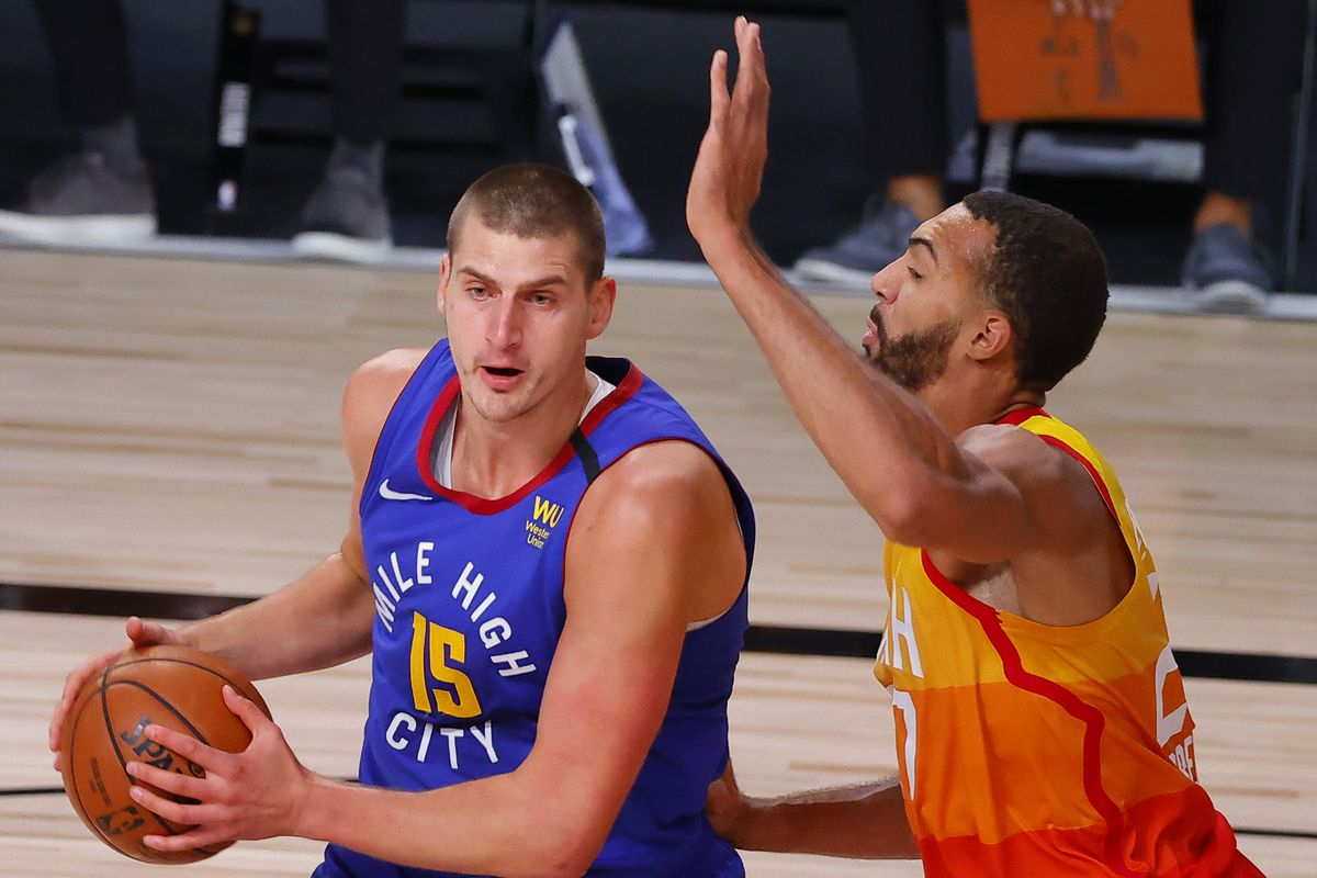 Nikola Jokic of the Denver Nuggets looks to pass against Rudy Gobert of the Utah Jazz in Game Six of the Western Conference First Round during the 2020 NBA Playoffs at AdventHealth Arena at ESPN Wide World Of Sports Complex on August 30, 2020 in Lake Buena Vista, Florida.