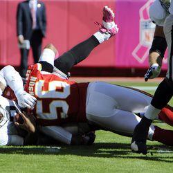 Kansas City Chiefs inside linebacker Derrick Johnson (56) sacks Oakland Raiders quarterback Terrelle Pryor (2) in the first half at Arrowhead Stadium.