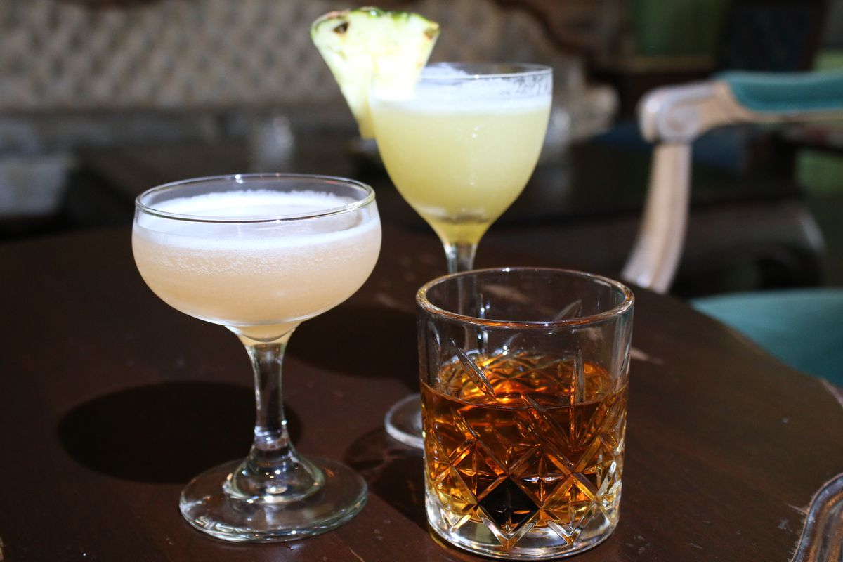 Gin cocktails served at Scofflaw include the Fitzgerald (from left), In Burma and Genever Martinez.