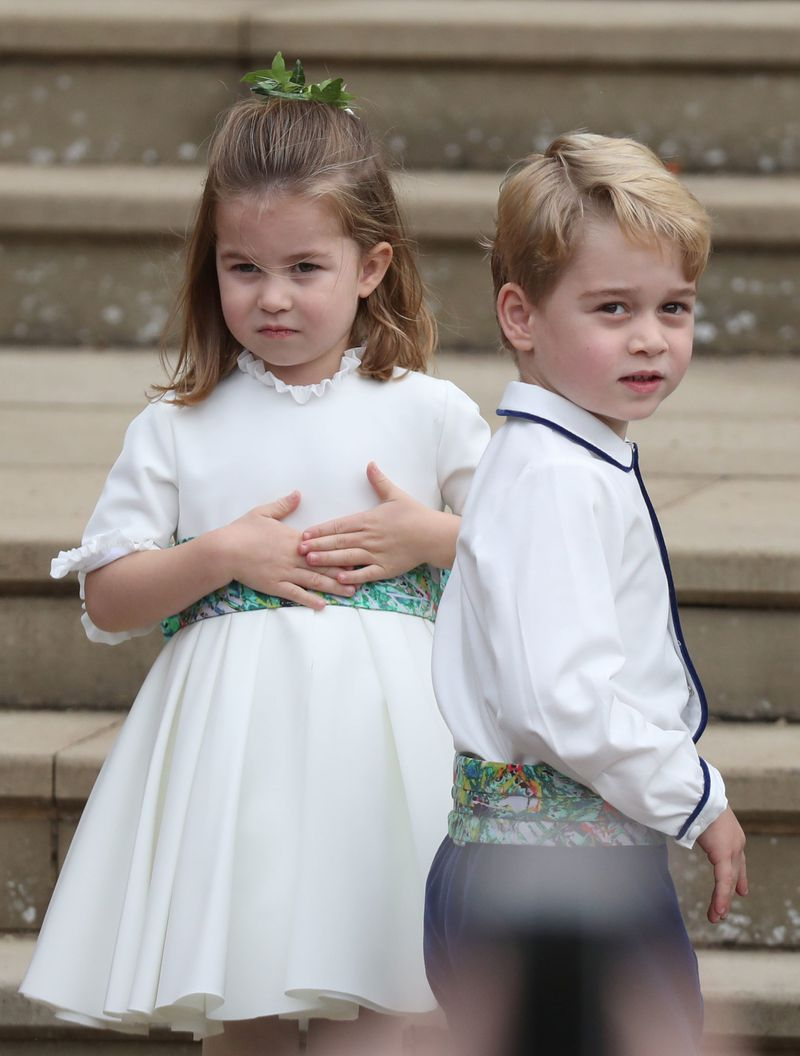The two children stand on the steps of St. George's Chapel at Windsor Castle.