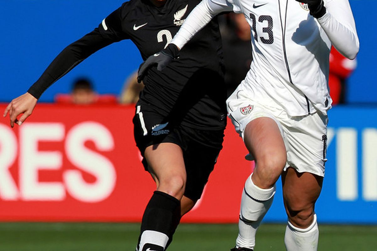 FRISCO, TX - FEBRUARY 11:  Alex Morgan #13 of USA dribbles the ball past Ria Percival #2 of New Zealand during an international friendly at FC Dallas Stadium on February 11, 2012 in Frisco, Texas.  (Photo by Ronald Martinez/Getty Images)