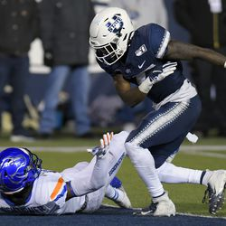 Utah State cornerback DJ Williams, right, throws Boise State wide receiver John Hightower to the ground after the play was over during the first half of an NCAA college football game Saturday, Nov. 23, 2019, in Logan, Utah. Both players received an unsportsmanlike-conduct penalty; it was Williams' second of the game and he was ejected.