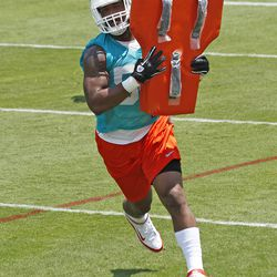 DAVIE, FL - MAY 23: Tariq Edwards #58 of the Miami Dolphins participates in drills during the rookie minicamp on May 23, 2014 at the Miami Dolphins training facility in Davie, Florida.