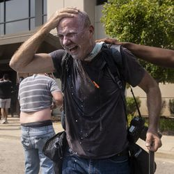 Getty photographer Scott Olson gets milk and water poured on his face after he was pepper sprayed while photographing protesters trying to enter the Kenosha Public Safety Building, Monday afternoon, Aug. 24, 2020. Protesters are gathered in downtown Kenosha, one day after police shot Jacob Blake.