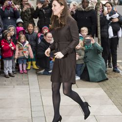 Arriving at The Fostering Network in London on January 16th, 2015 in a Hobbs dress.