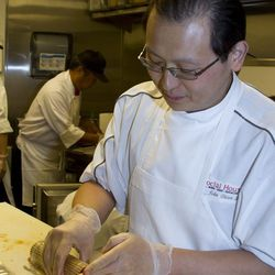 Social House executive chef John Chien Lee tightens up the roll.