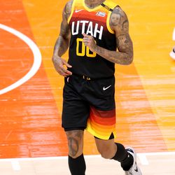 Utah Jazz guard Jordan Clarkson (00) smiles after missing a long shot at the halftime buzzer as the Utah Jazz and the Memphis Grizzlies play in game 5 at Vivint Arena in Salt Lake City on Wednesday, June 2, 2021. Utah won 126-110, Utah advances to the second round.