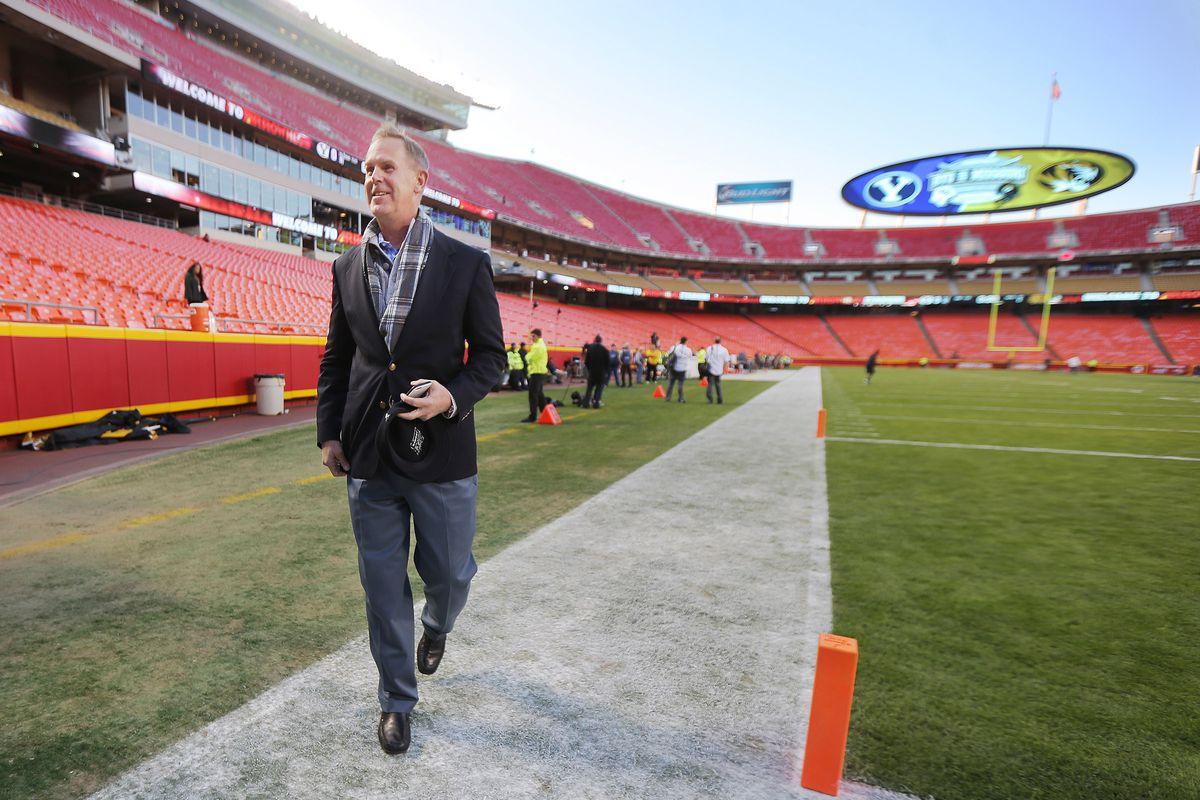 BYU Director of Athletics Tom Holmoe, walks on the field at Arrowhead Stadium prior to a game with Missouri in Kansas City, Missouri, Saturday, Nov. 14, 2015.