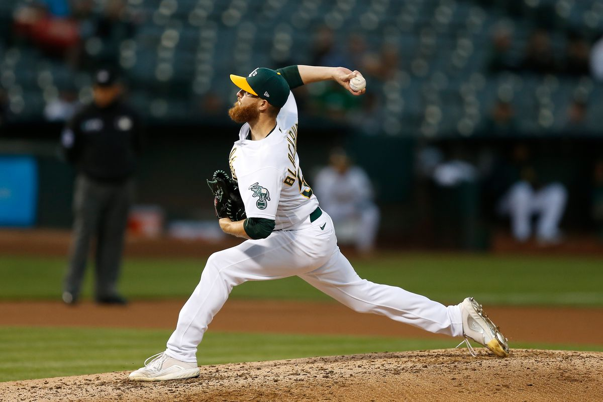 Paul Blackburn #58 of the Oakland Athletics pitches against the Seattle Mariners at RingCentral Coliseum on August 23, 2021 in Oakland, California.