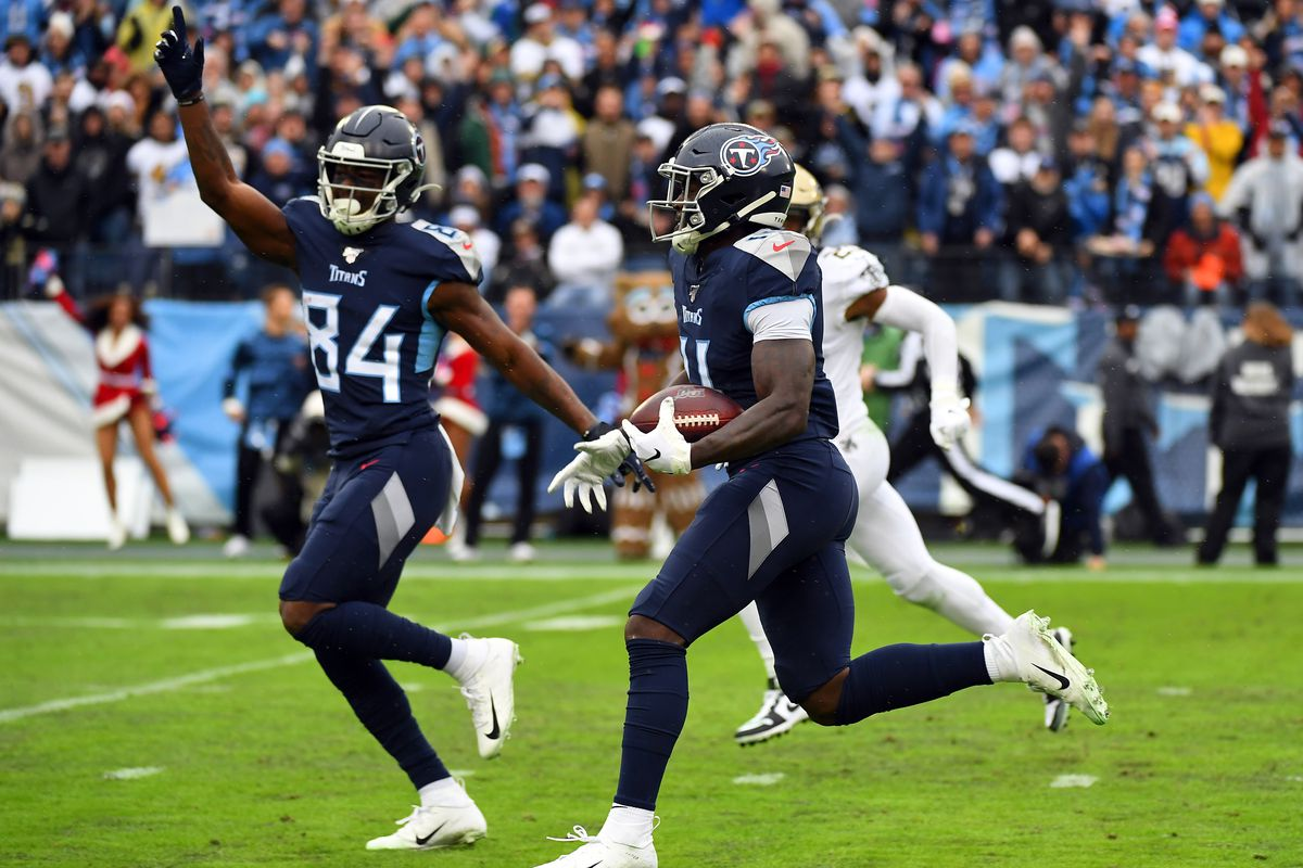 Tennessee Titans wide receiver A.J. Brown runs for a touchdown after a reception as wide receiver Corey Davis celebrates during the first half against the New Orleans Saints at Nissan Stadium.