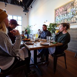 Kaleen and Nate Haines, of Alaska, left, talk with friends Dallas and Jessica Frame, of Utah, as they enjoy a meal at Oak Wood Fire Kitchen in Draper on Tuesday, Dec. 8, 2020.