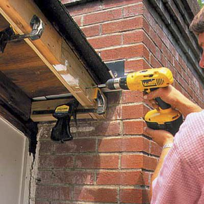 Man Attaches New Rafter To Chimney Cleat