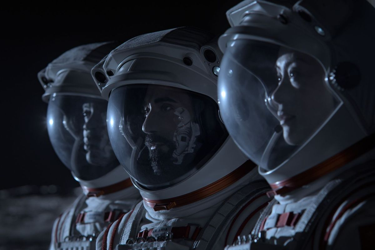 An array of spacesuited astronauts stand side by side in the dark in Netflix's Away.