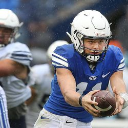 BYU's QB Zach Wilson fakes a handoff to Riley Burt during the Blue-White game at LaVell Edwards Stadium in Provo on Saturday, April 7, 2018.