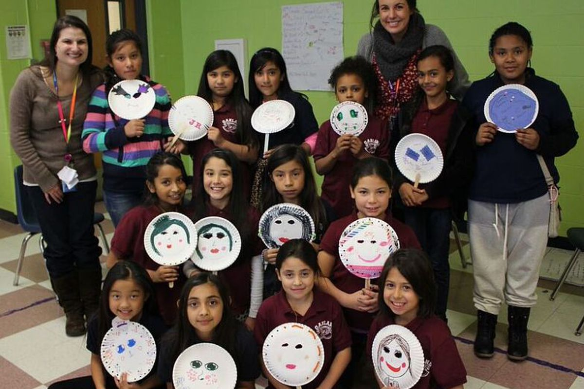 Students at Oakland Elementary hold up masks they decorated to represent who they are on the inside. The activity was part of one of the school's preventative programs for girls. (Photo courtesy of Oakland)