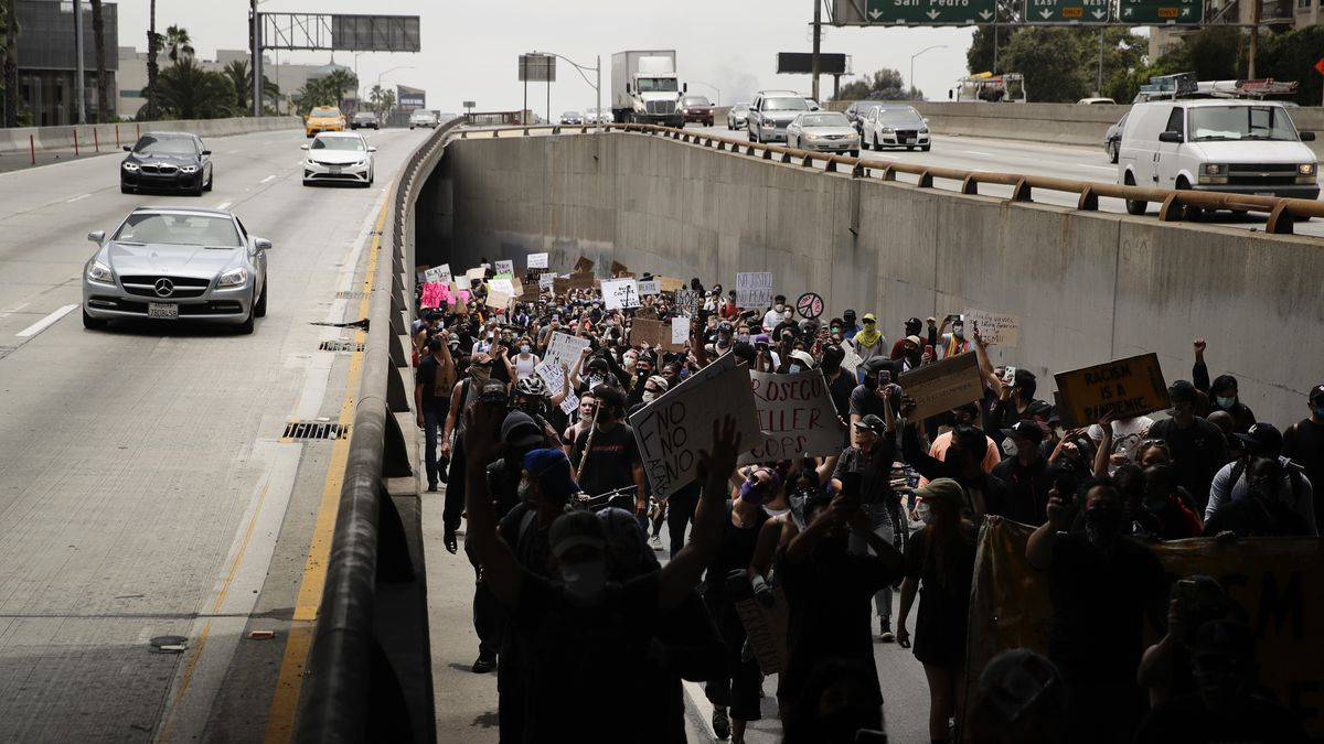 Demonstrators march onto the 110 Freeway, in Los Angeles, Tuesday, June 2, 2020, in a protest over the death of George Floyd, who died after being restrained by Minneapolis police officers on May 25.