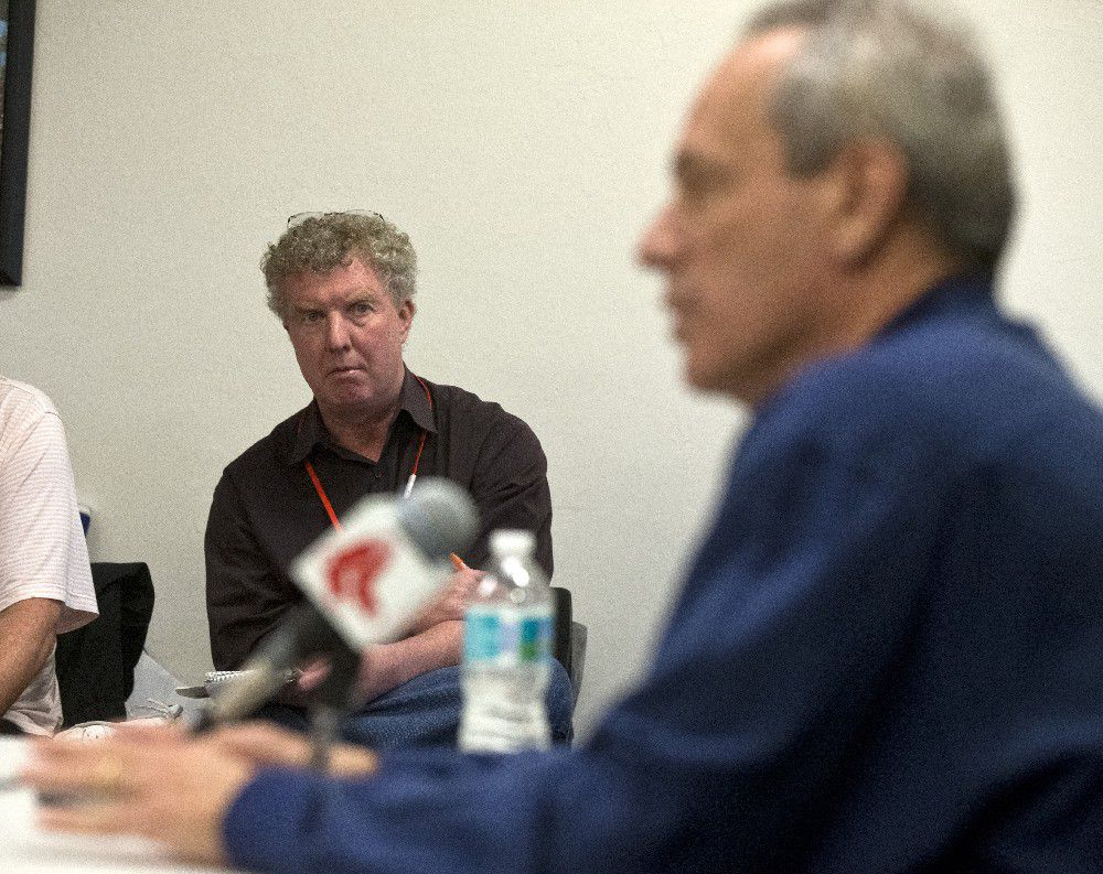 Shaughnessy at a press conference with then–Red Sox president Larry Lucchino in 2013 (Boston Globe viaGetty)
