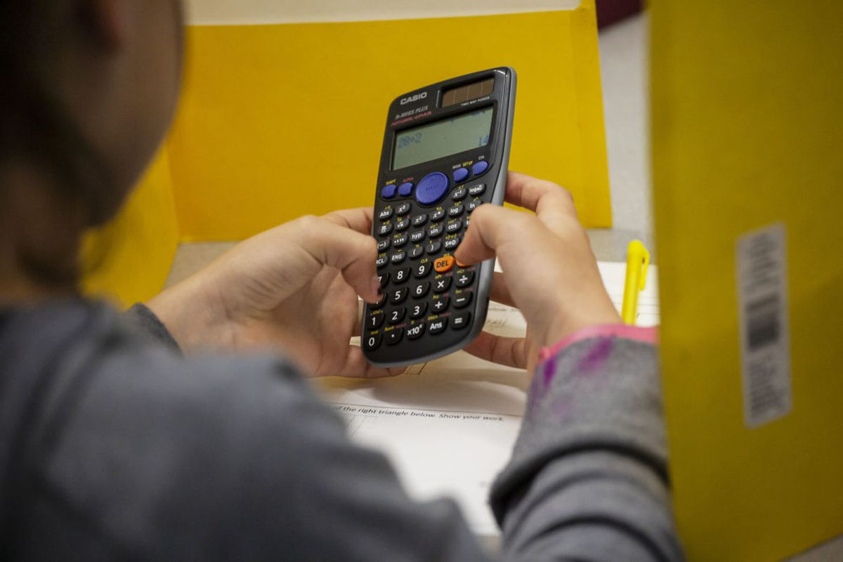 A Noel Community Arts School student works on a calculator during a tutoring period in May 2019.