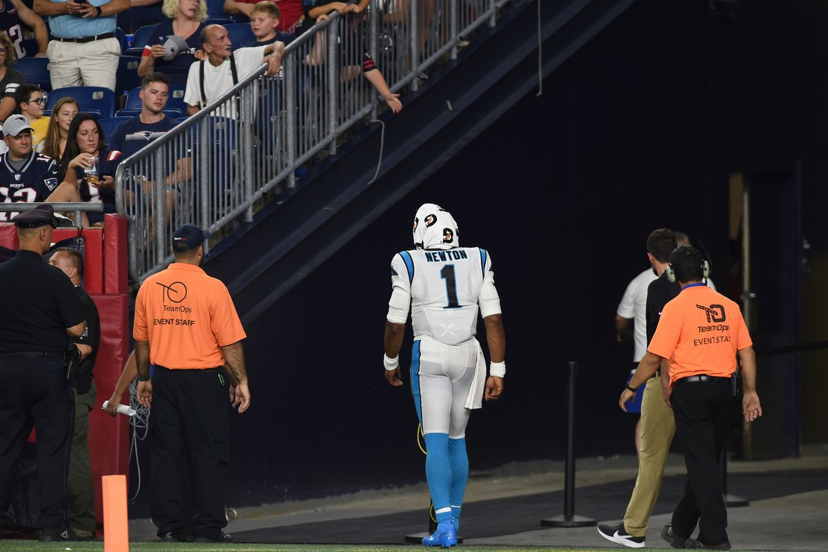 e98b2ce8 Carolina Panthers QB Cam Newton injures foot, wearing boot after ...