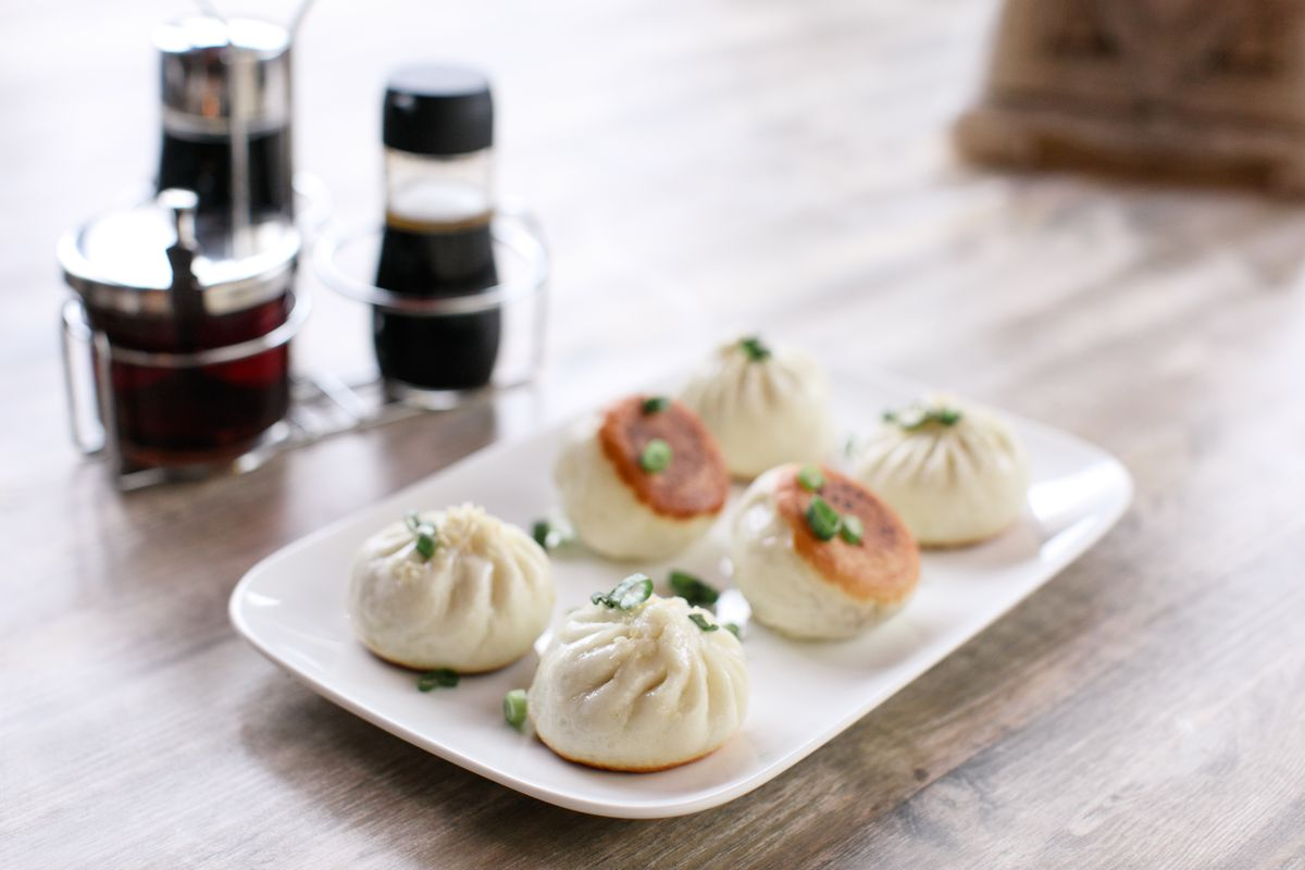 white plate with dumplings