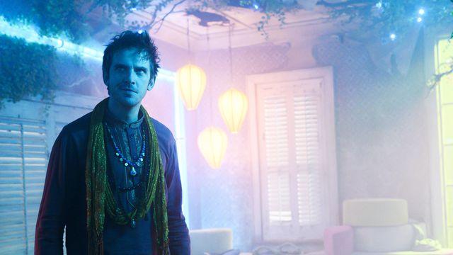 David Haller (Dan Stevens) stands in a misty, multicolored room in the penultimate episode of Legion