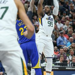 Utah Jazz forward Jae Crowder (99) shoots over Golden State Warriors forward Draymond Green (23) during the game at Vivint Arena in Salt Lake City on Tuesday, April 10, 2018.