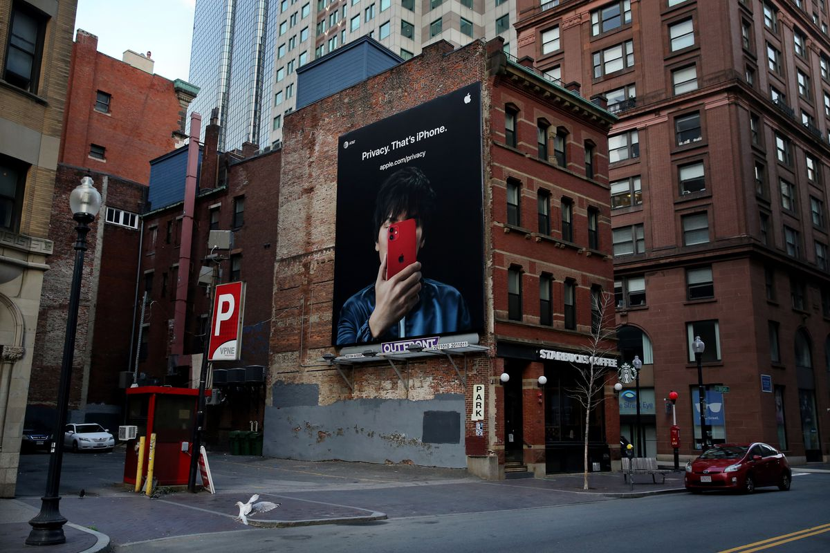 VPNE Parking Solution lot with an Apple iPhone billboard regarding privacy on Broad Street in Boston on October 7, 2020.