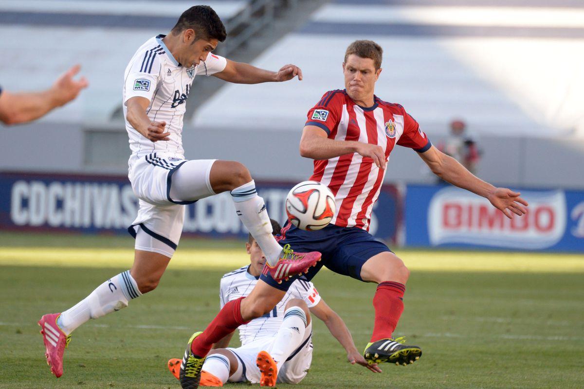 Vancouver Whitecaps DM Matias Laba sends the ball upfield versus Chivas USA.