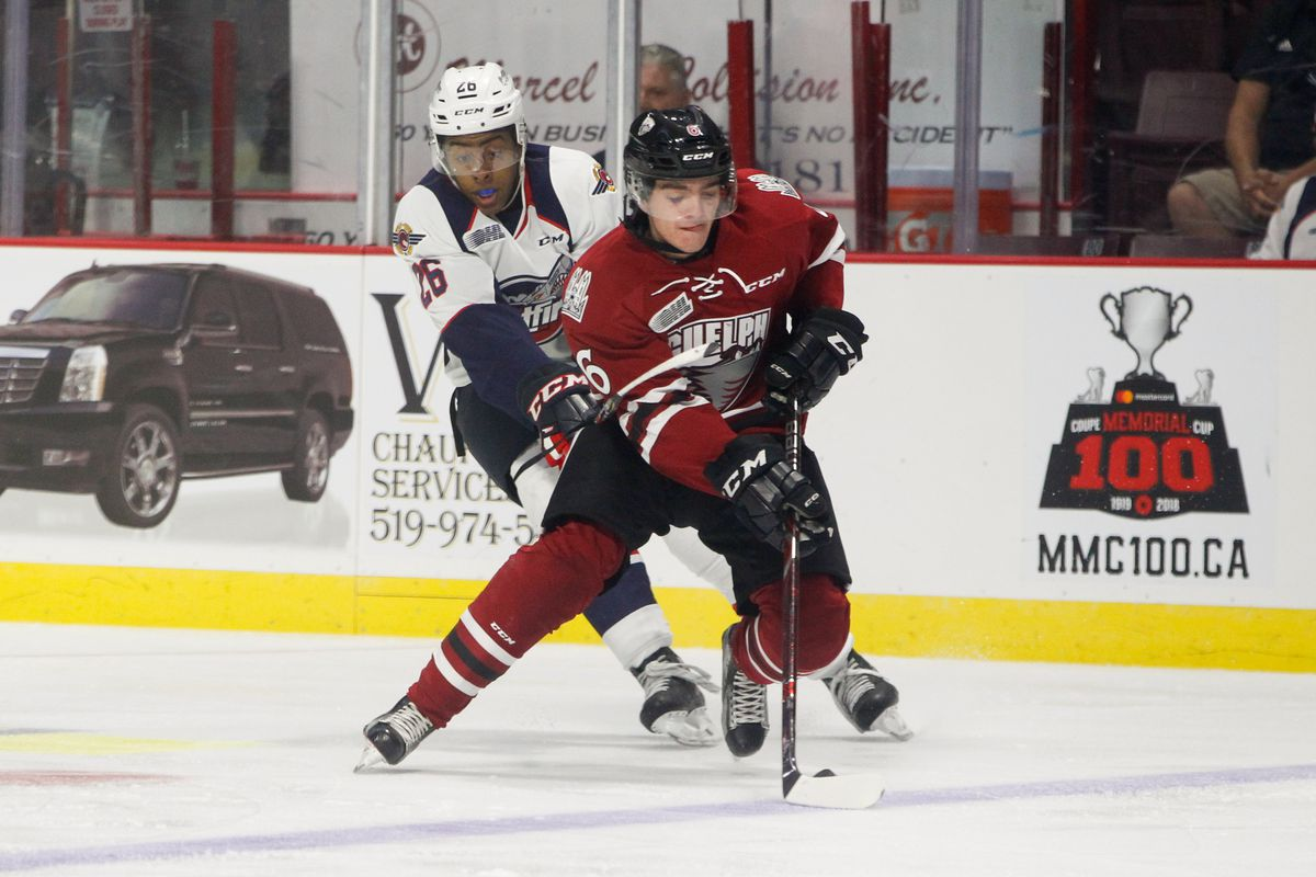 WINDSOR, ON - SEPTEMBER 24: Defenceman Ryan Merkley #6 of the Guelph Storm moves the puck against Cole Purboo #26 of the Windsor Spitfires on September 24, 2017 at the WFCU Centre in Windsor, Ontario, Canada.