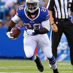 Aug 16, 2013; Orchard Park, NY, USA;  Buffalo Bills running back C.J. Spiller (28) runs the ball during the first half against the Minnesota Vikings at Ralph Wilson Stadium.