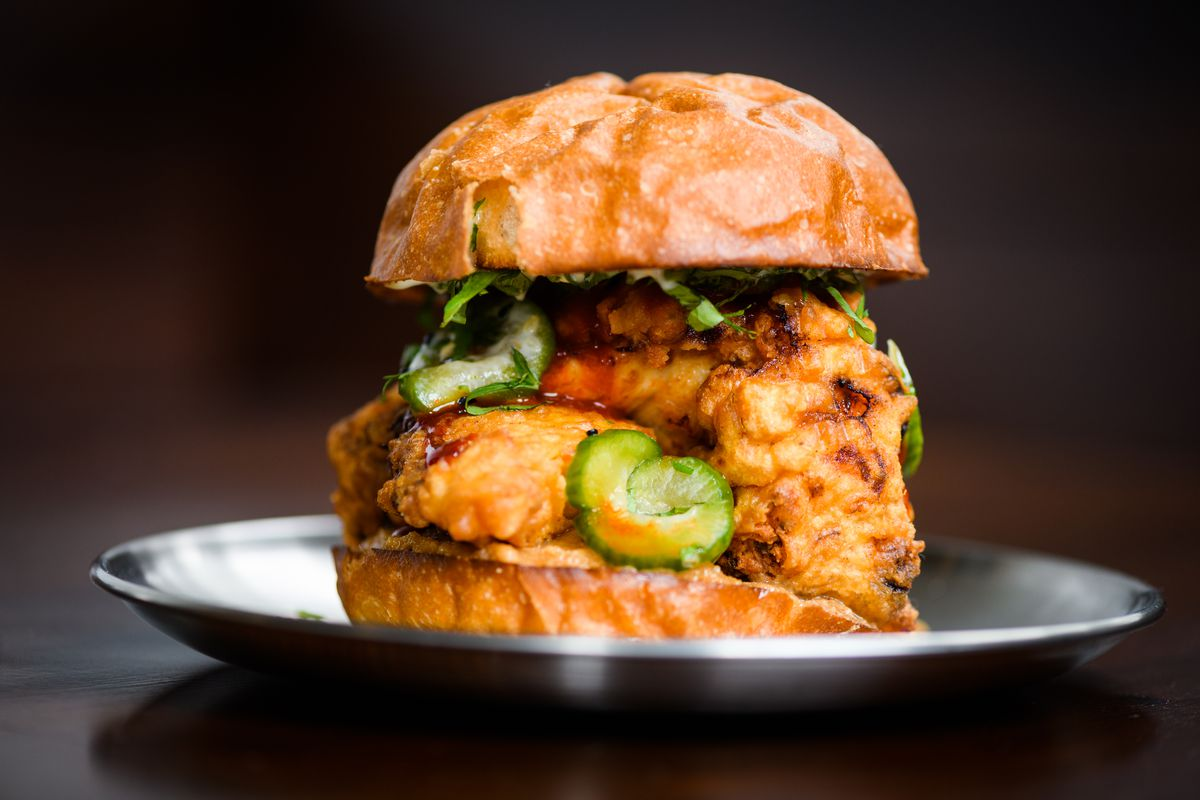 A fried chicken sandwich at Steeplejack comes with Japanese pickles, cilantro, and gochujang sauce.