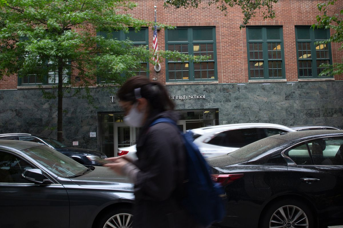 A student walks by Eleanor Roosevelt High School on the Upper East Side, May 24, 2021.