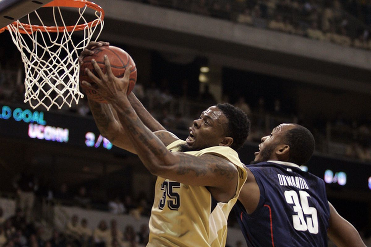 PITTSBURGH PA - DECEMBER 27:  Nasir Robinson #35 of the Pittsburgh Panthers pulls down a rebound against the Connecticut Huskies at Petersen Events Center on December 27 2010 in Pittsburgh Pennsylvania.  (Photo by Justin K. Aller/Getty Images)