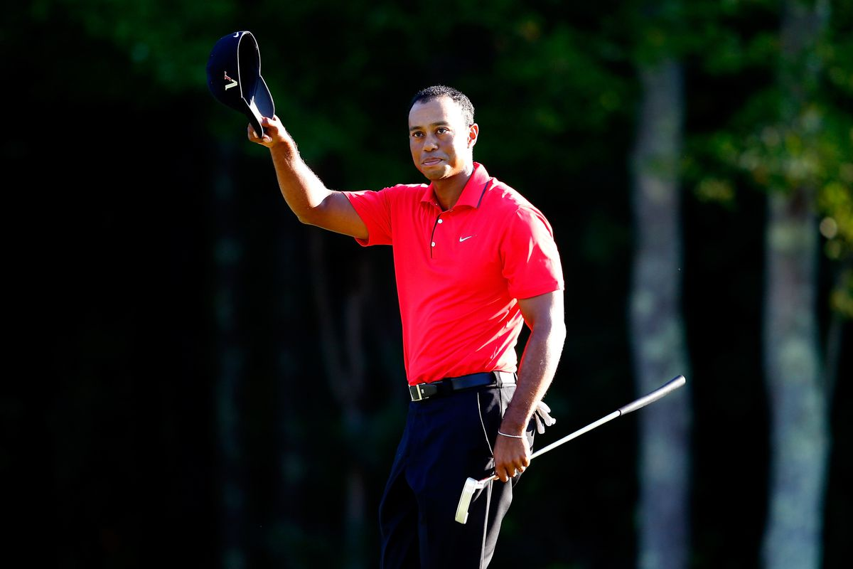 NORTON, MA - SEPTEMBER 03:  Tiger Woods reacts after finishing the final round of the Deutsche Bank Championship at TPC Boston on September 3, 2012 in Norton, Massachusetts.  (Photo by Jim Rogash/Getty Images)