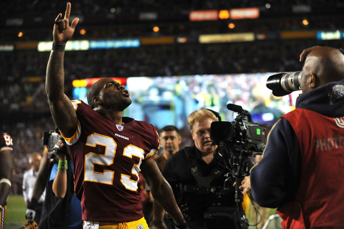 LANDOVER - SEPTEMBER 12:  DeAngelo Hall #23 of the Washington Redskins celebrates his touchdown during the NFL season opener against the Dallas Cowboys at FedExField on September 12 2010 in Landover Maryland.  (Photo by Larry French/Getty Images)
