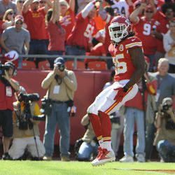 Kansas City Chiefs running back Jamaal Charles (25) celebrates after scoring a touchdown against the Oakland Raiders in the second half at Arrowhead Stadium. Kansas City won the game 24-7.