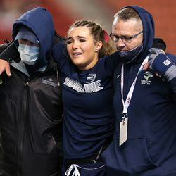 Ridgeline's Halle Van Yperen walks off the field with the help of her coaches after she was injured during a 4A high school girls soccer semifinal at Rio Tinto Stadium in Sandy on Thursday, Oct. 22, 2020.