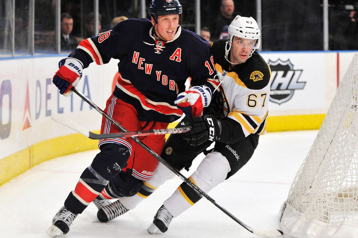 NEW YORK, NY - MARCH 04:  Marc Staal #18 of the New York Rangers skates against Benoit Pouliot #67 of the Boston Bruins during the first period at Madison Square Garden on March 4, 2012 in New York City. (Photo by Christopher Pasatieri/Getty Images)