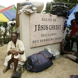 Marie Terez Antenor, who claims to be 100 years old, sits by the LDS church Centrale Ward sign where her family is temporarily living in Port-au-Prince, Haiti, Tuesday, Jan. 26, 2010.
