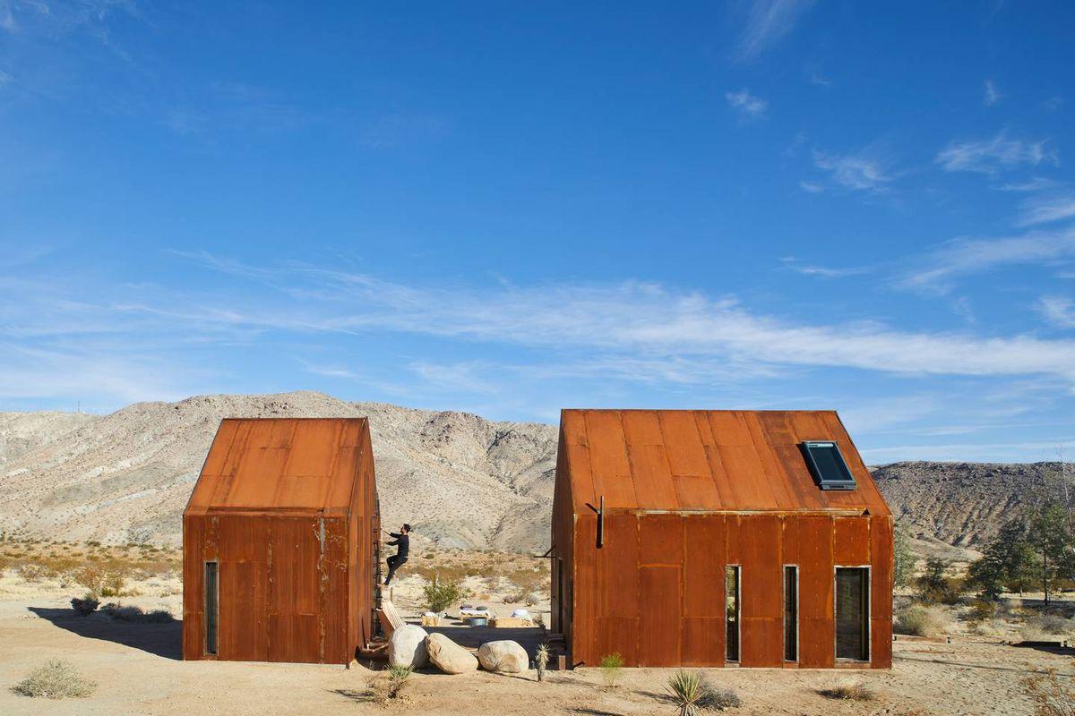 Two steel cabins in desert