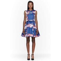 "MSGM <a href=""http://www.ssense.com/women/product/msgm/blue_satin_floral_print_duchesse_dress/84794"">blue satin floral print duchess dress</a>, $550 (on sale) at ssense.com.<br /><br />  For luxury with an international bent, <b>Ssense</b> has more than"