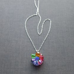 There are 11 different colors in every Lavaliere necklace and structured a bit differently from the next. The multi-color beauty will literally match everything in your closet.<br />$74