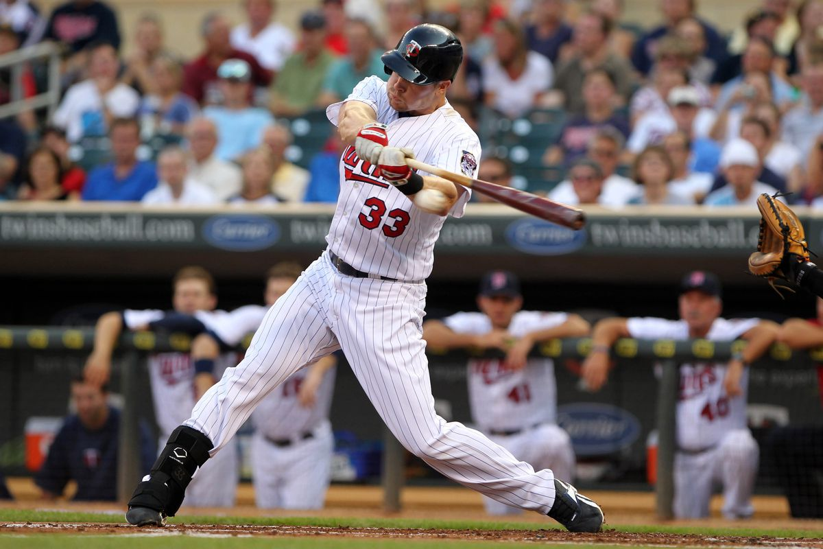 July 16, 2012; Minneapolis, MN, USA; Minnesota Twins first baseman Justin Morneau (33) hits a double during the first inning against the Baltimore Orioles at Target Field. Mandatory Credit: Brace Hemmelgarn-US PRESSWIRE
