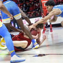 Utah Utes forward Mikael Jantunen (20) attempts to secure the ball against the UCLA Bruins at the Jon M. Huntsman Center in Salt Lake City on Thursday, Feb. 20, 2020.
