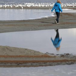 Celeste Smith, of Fredericksburg, Va., visits the Great Salt Lake on Wednesday, Oct. 30, 2013. Gov. Gary Herbert is in the process of developing a 50-year water vision for Utah. To lead out this effort, the governor will organize the State Water Plan Advisory Team.