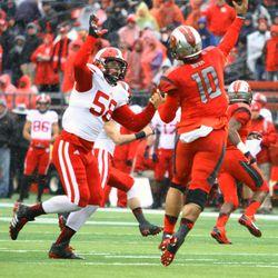 Linebacker Joe Schobert attempts to bat down a pass from Rutgers quarterback Gary Nova.