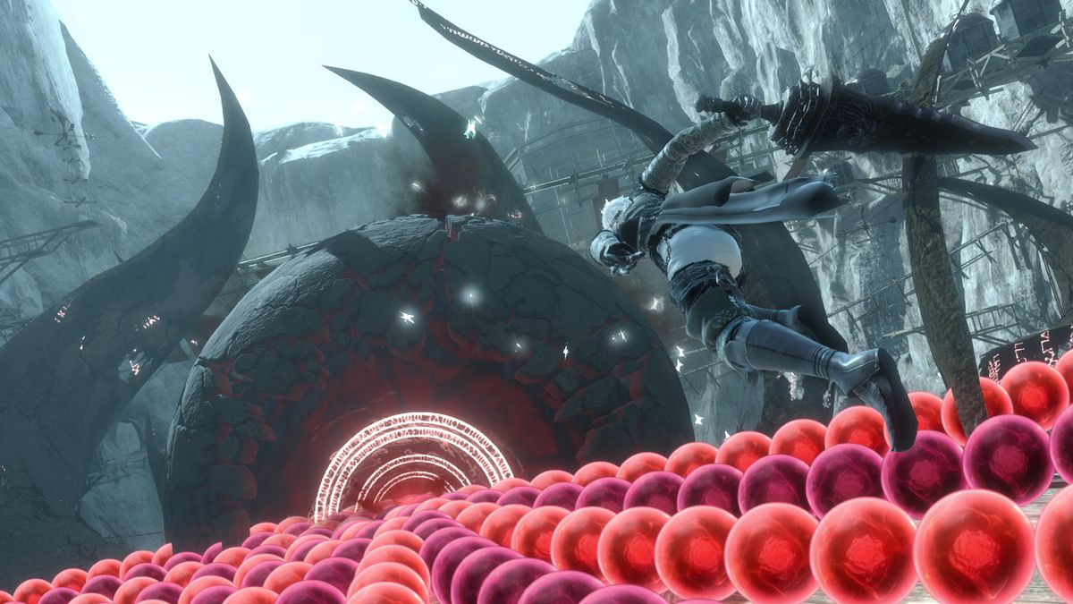 Nier battles a bullet hell boss in a screenshot from Nier Replicant's remaster